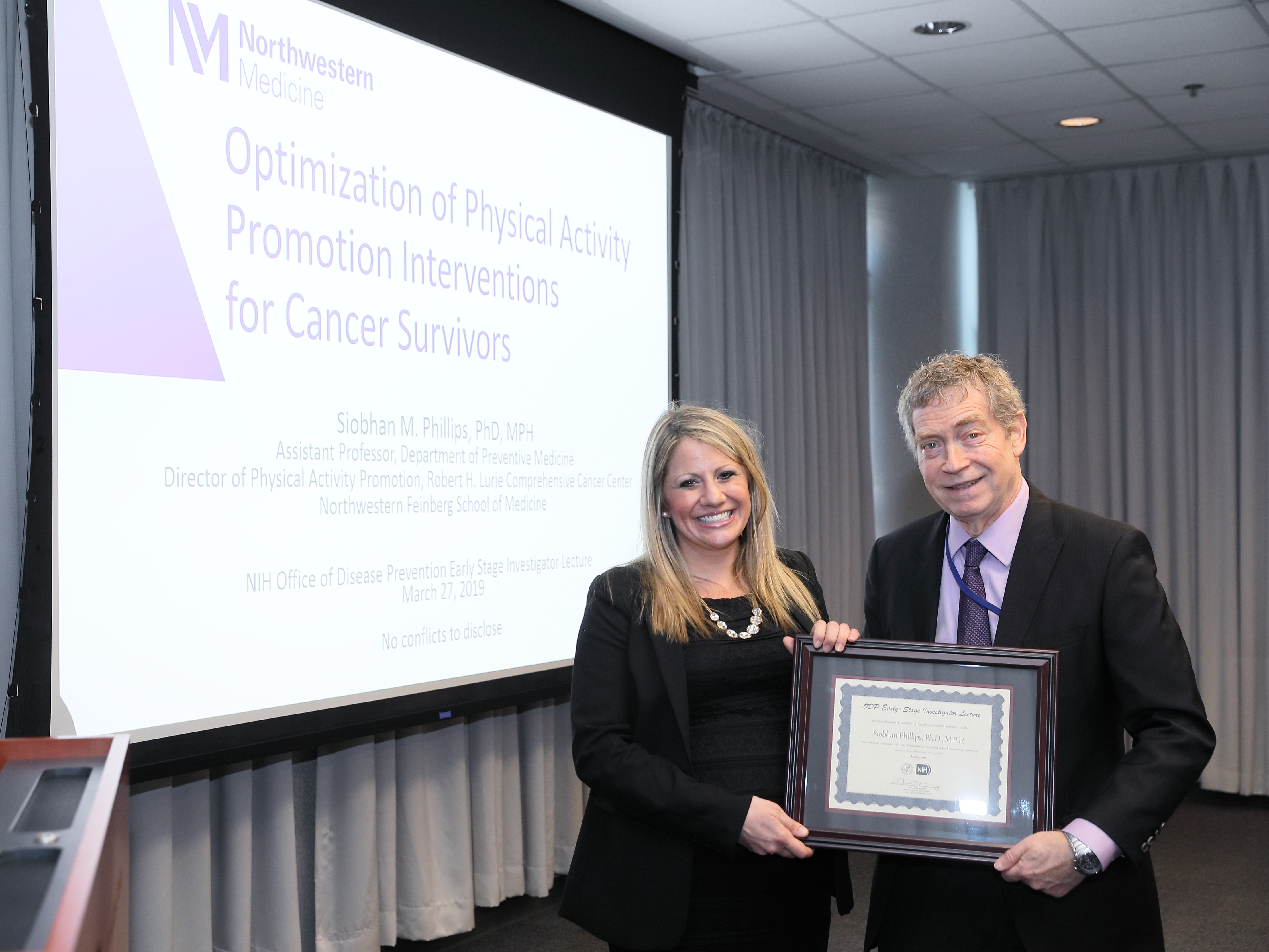 Dr. Phillips receives a certificate from ODP Director Dr. Murray